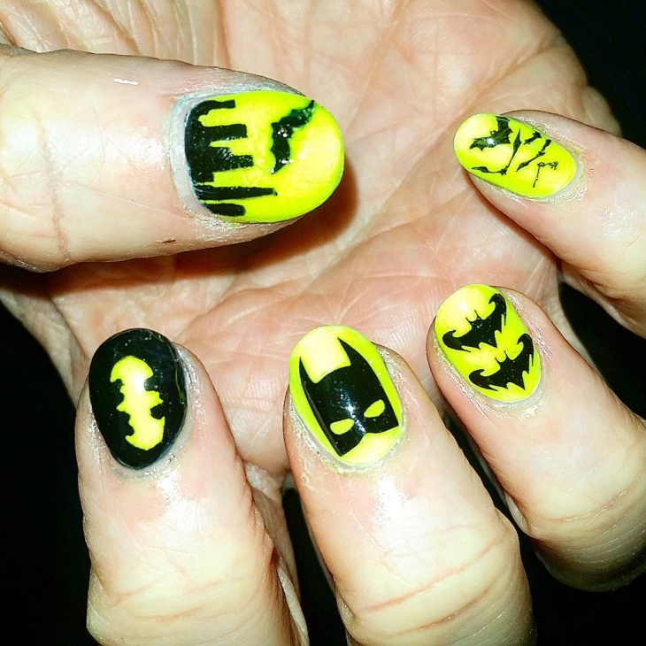 yellow and black bat nail design