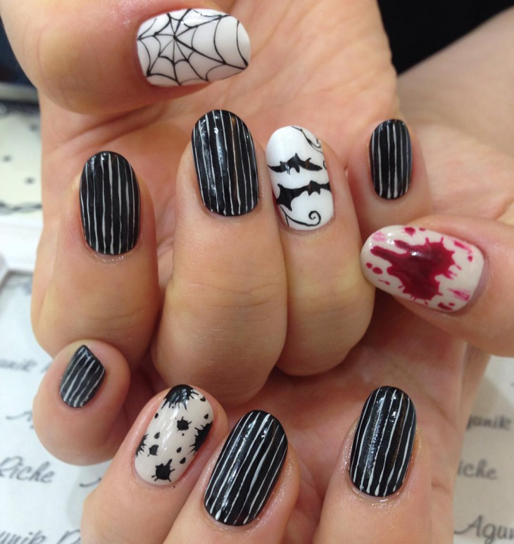 bat and spiderweb nail art design