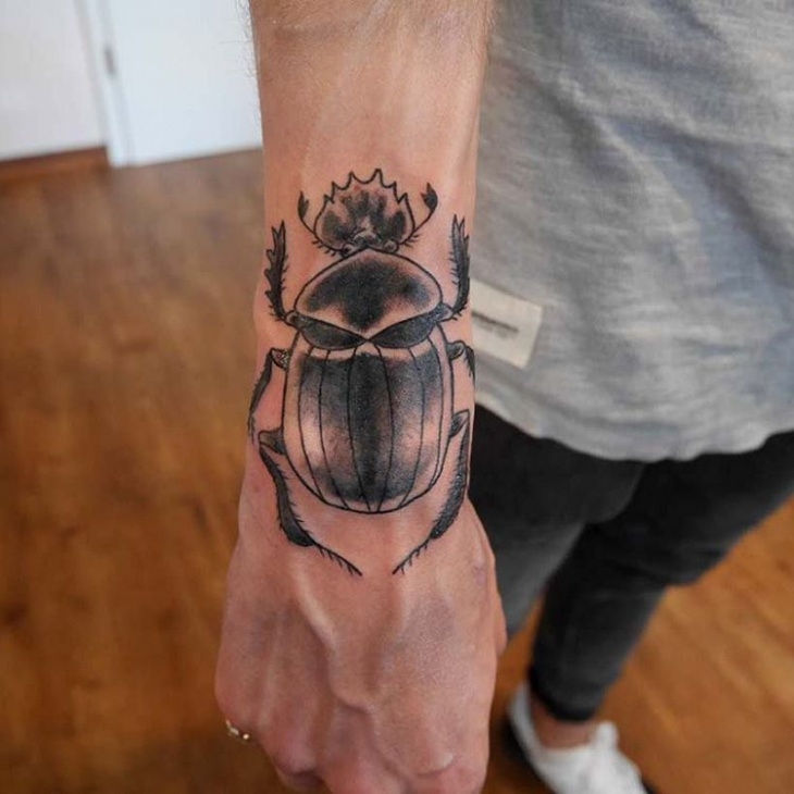 Black Ink Scarab Tattoo Idea