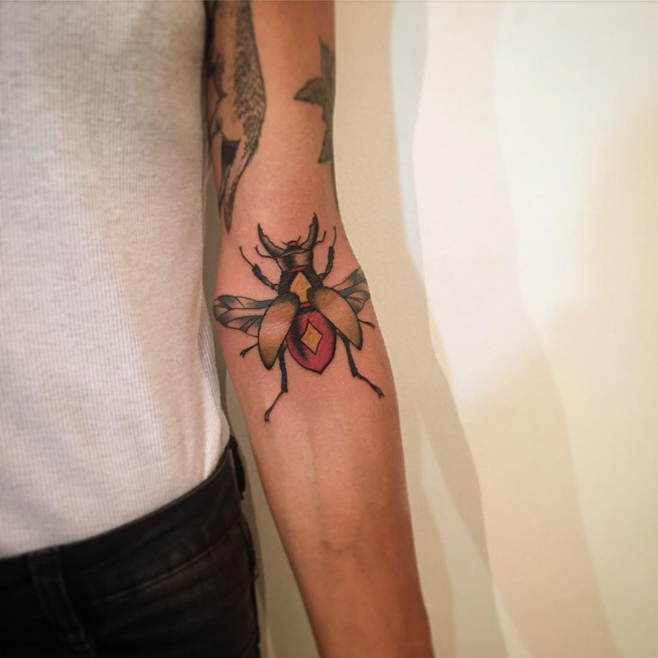 neo traditional scarab tattoo