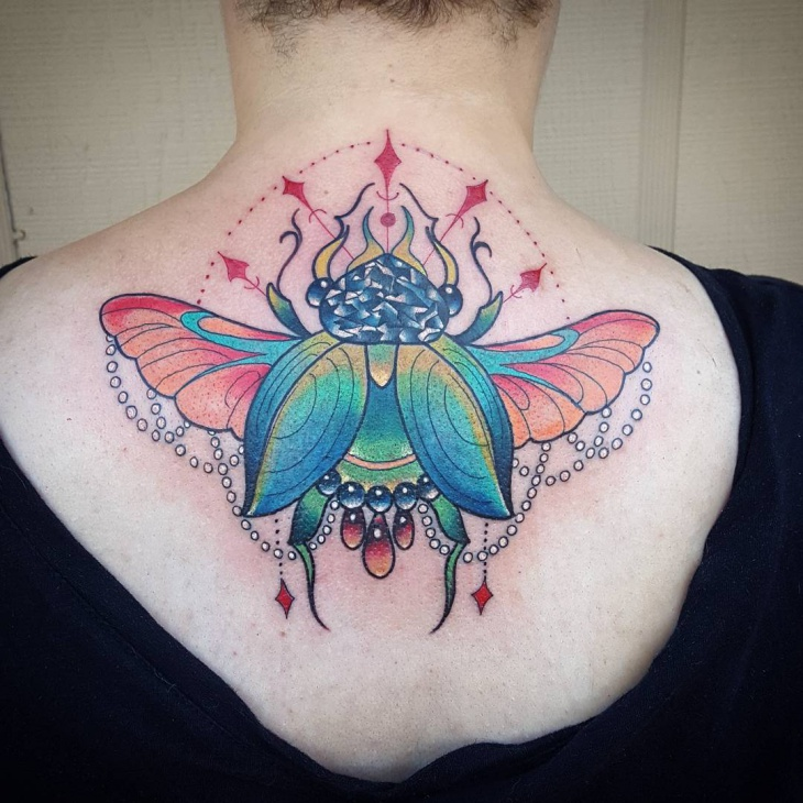 colorful scarab tattoo on back