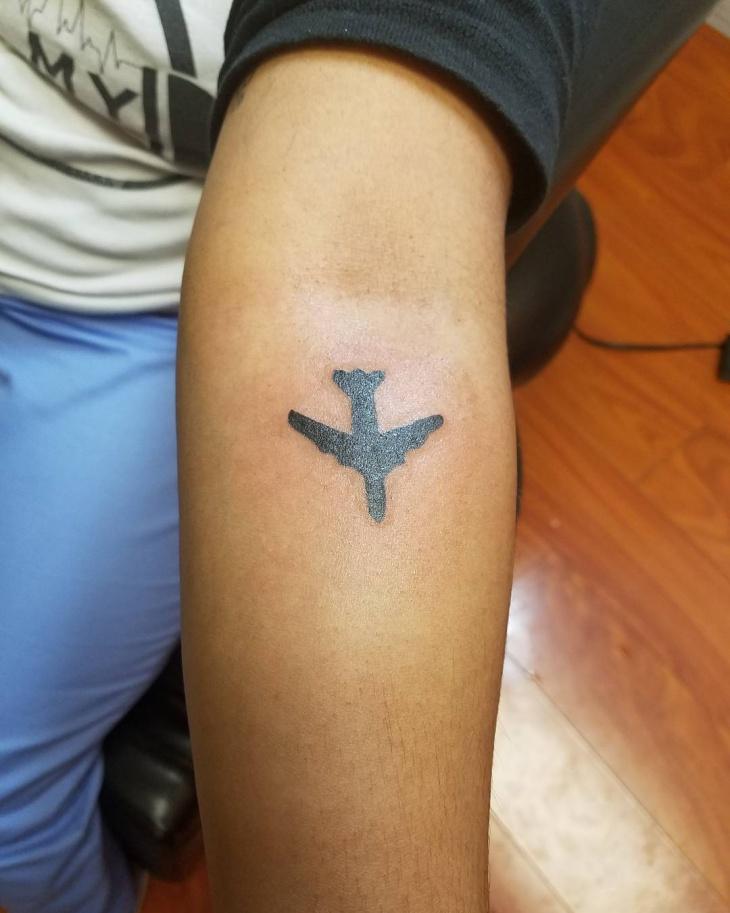 black airplane tattoo idea
