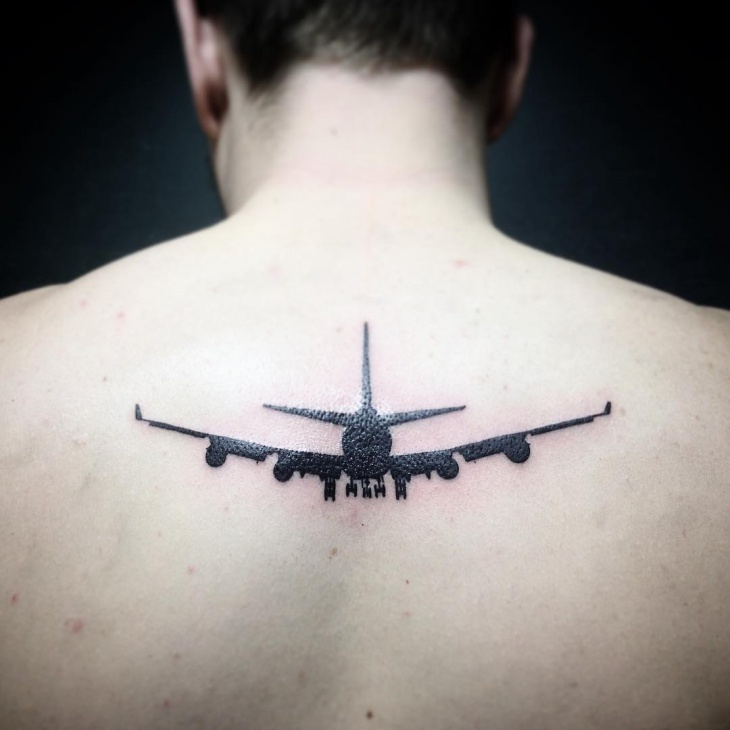 small airplane chest tattoo
