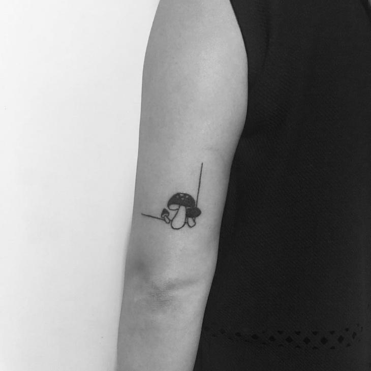 small mushroom tattoo