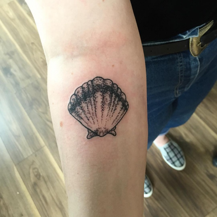 shell tattoo on forearm