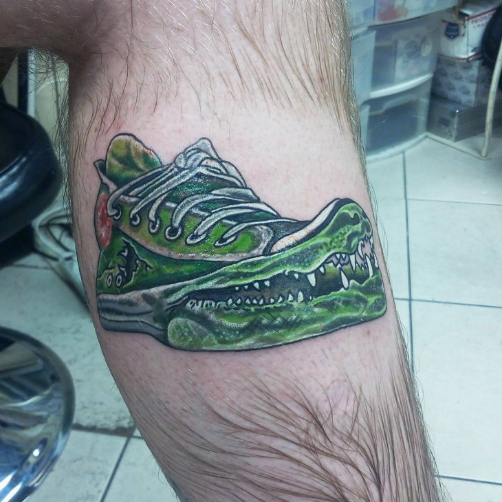 alligator tattoo on leg