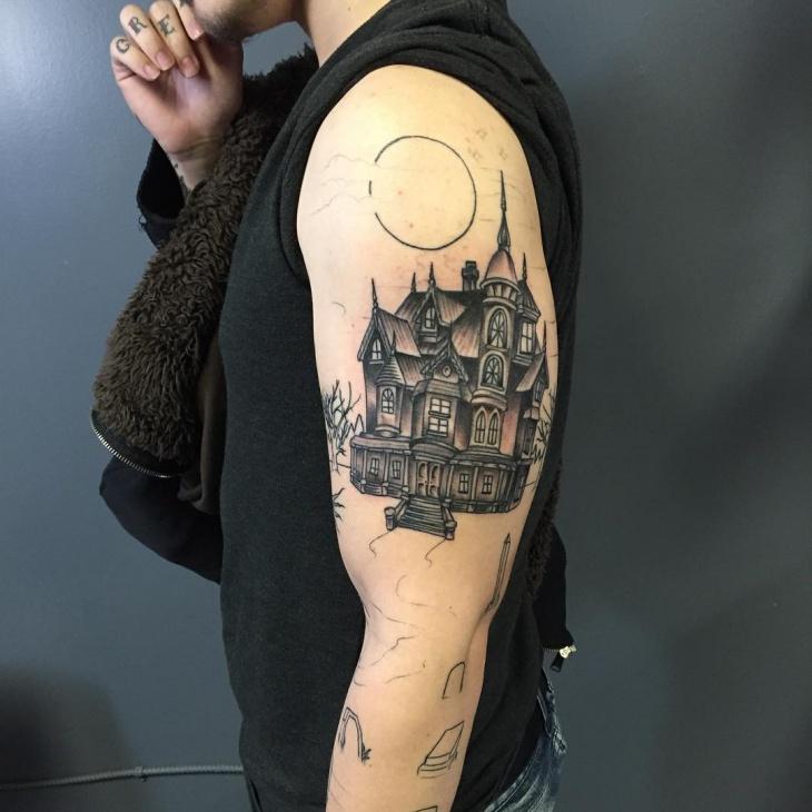half sleeve haunted house tattoo