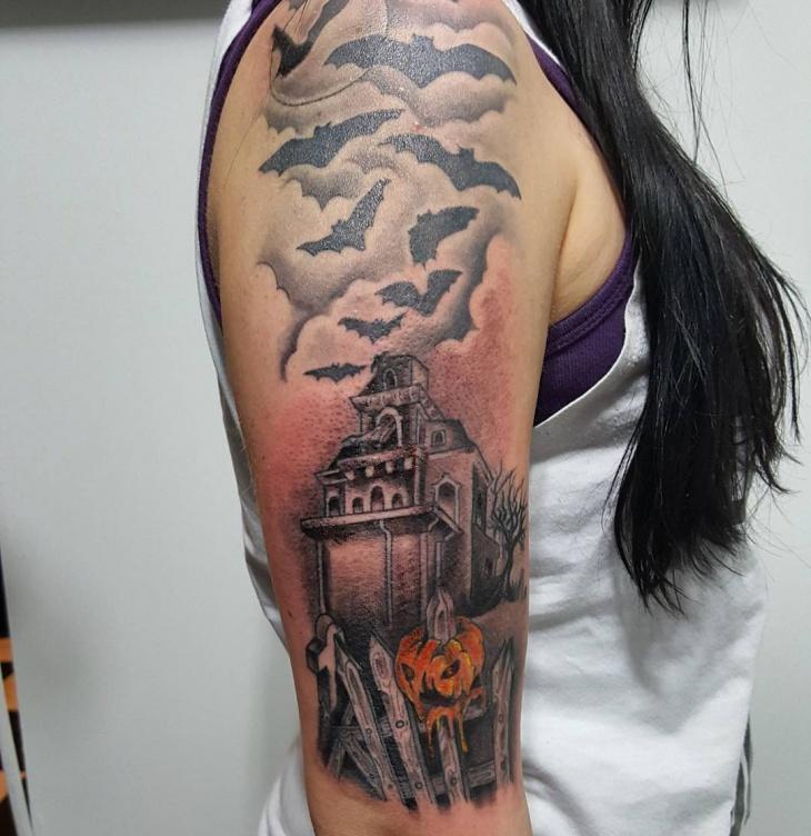 skull haunted house tattoo