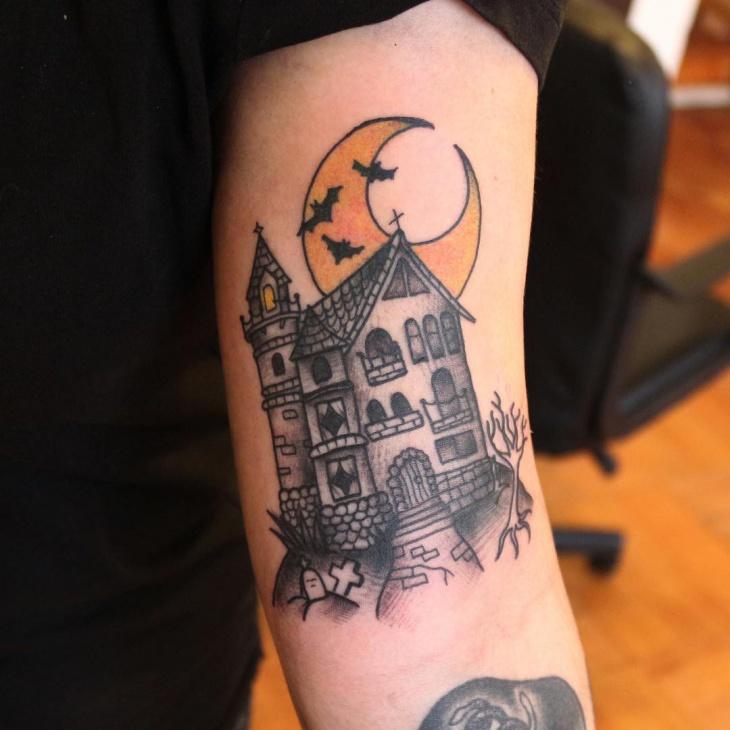 moon haunted house tattoo idea
