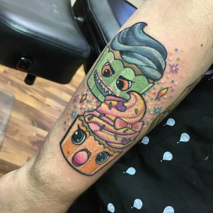 cupcake tattoo on hand