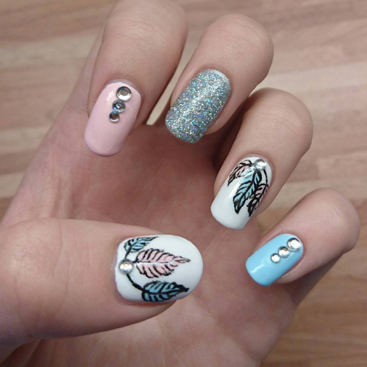 feather nail art with rhinestones