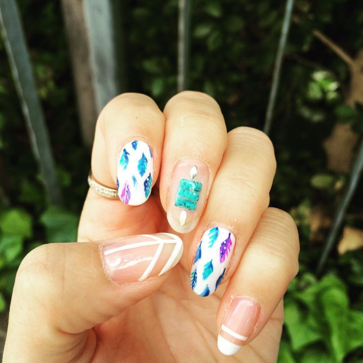 pretty feather nail design