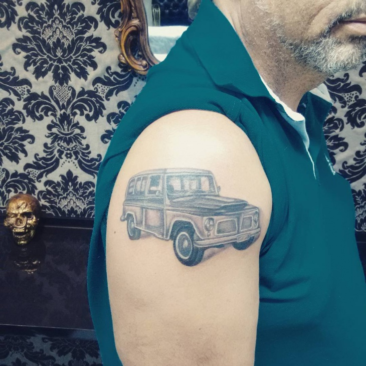 car tattoo on shoulder