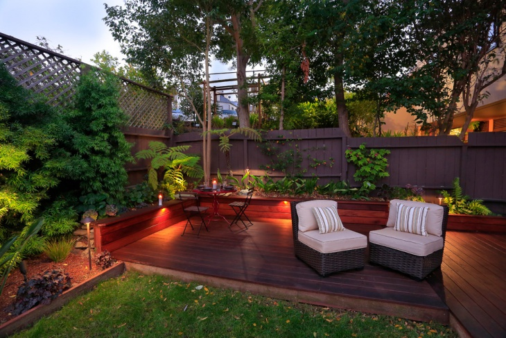ground level deck backyard sofa