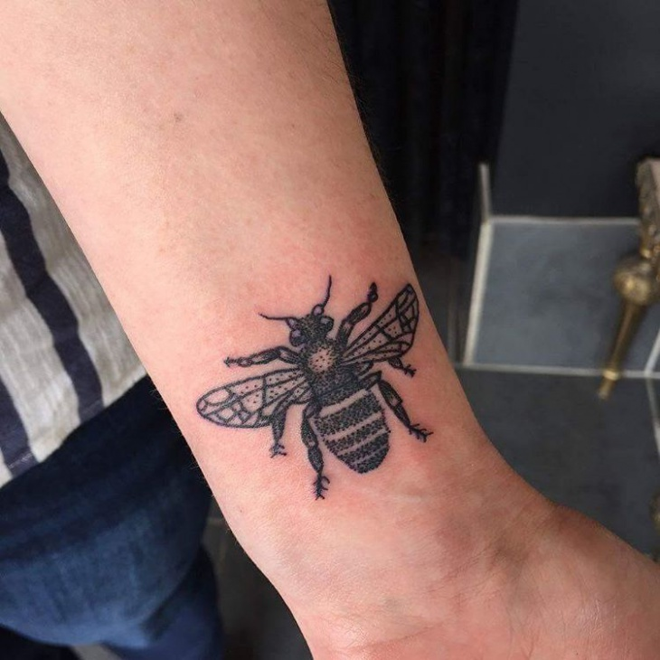 bumble bee wrist tattoo