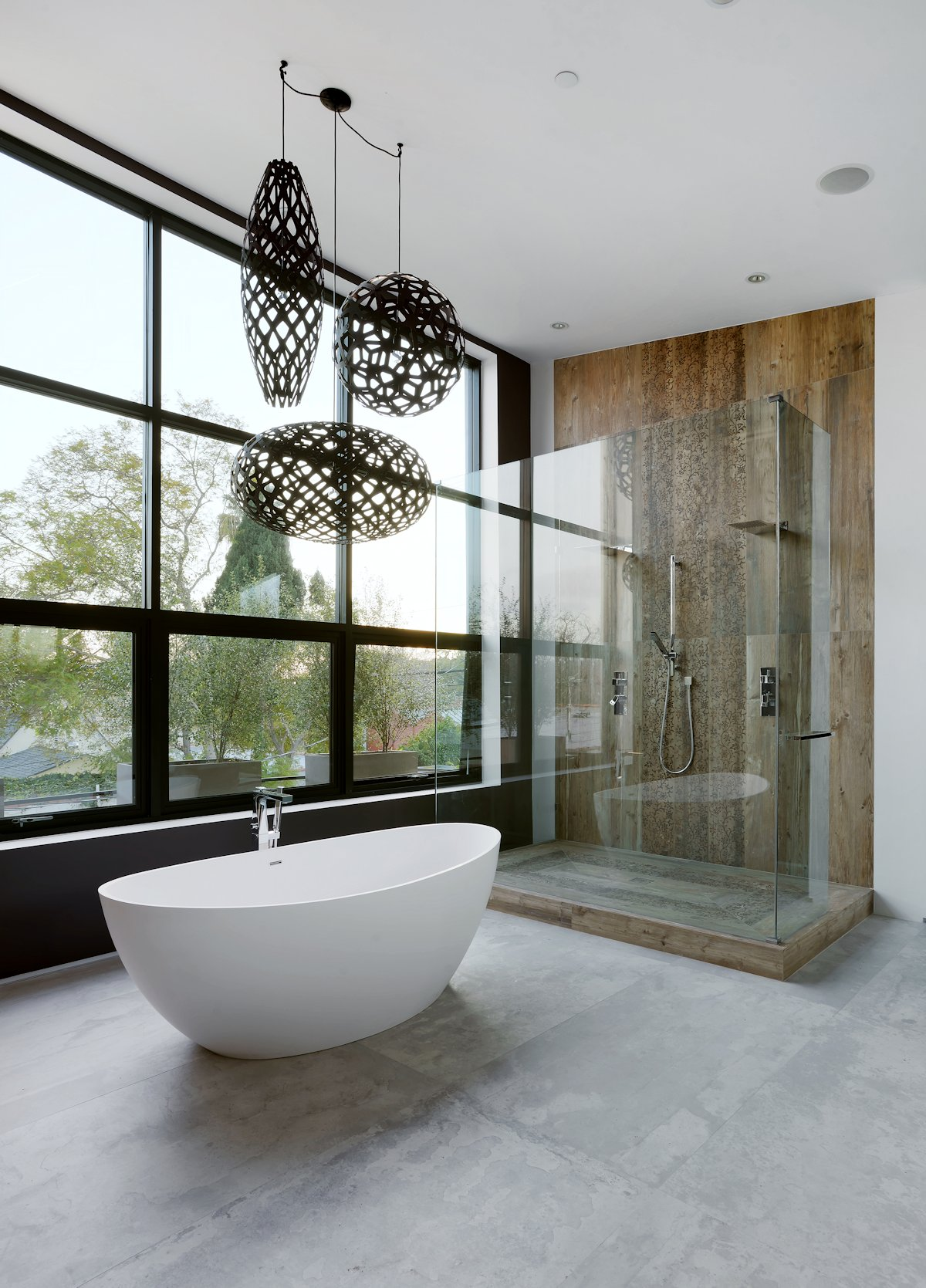 Concrete Floor Bathtub with Chandelier