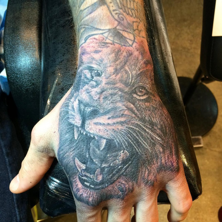 lion head tattoo on palm
