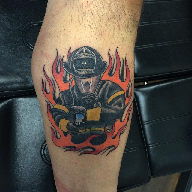 colorful firefighter symbol tattoo
