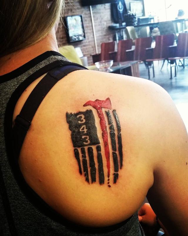 firefighter tattoo on shoulder