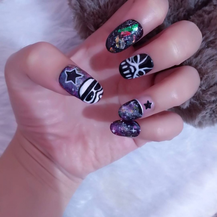 tribal galaxy nail art idea