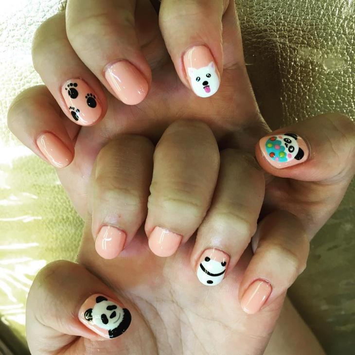 panda and paw print nail design