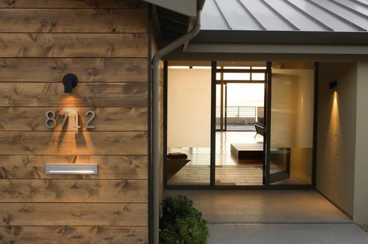 classy glass house door idea