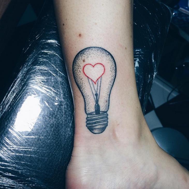 light bulb ankle tattoo