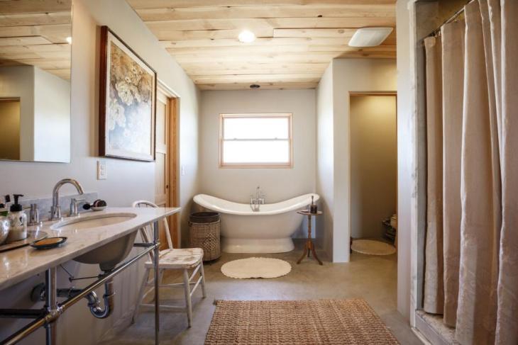 eclectic bathroom concrete floor