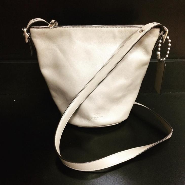small white designer handbag