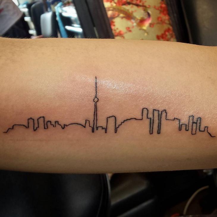 skyline hand tattoo design