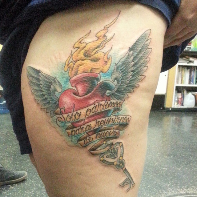 Burning Heart with Wings Tattoo