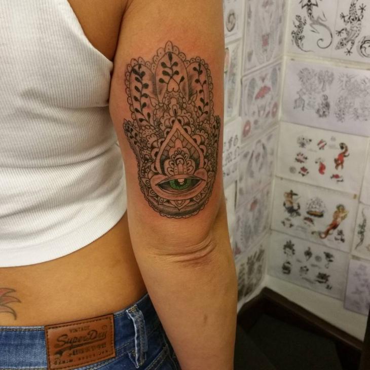 hamsa arm tattoo