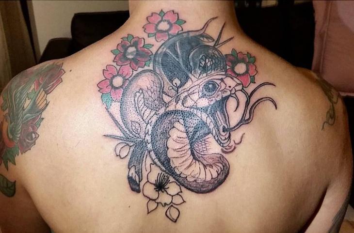 cobra tattoo on back