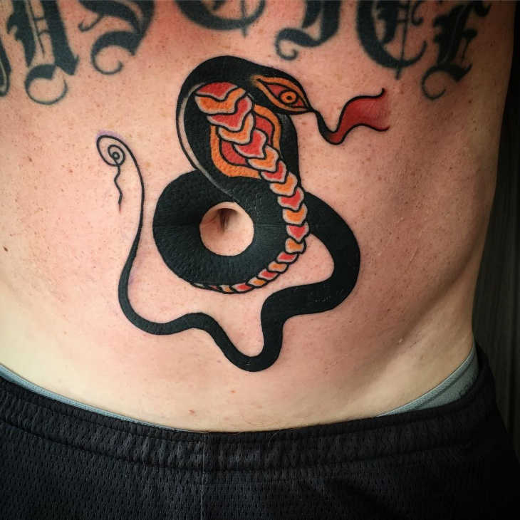 cobra tattoo on stomach