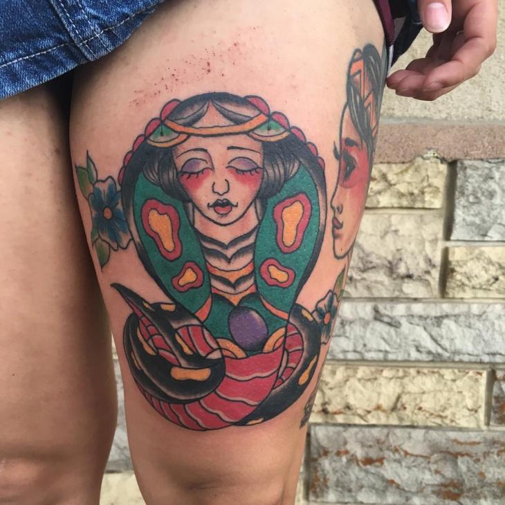 cobra tattoo on thigh