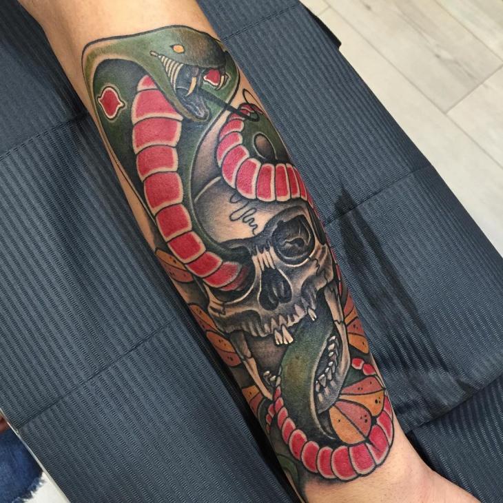 cobra and skull tattoo on hand