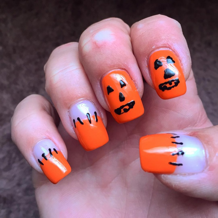black and orange pumpkin nails