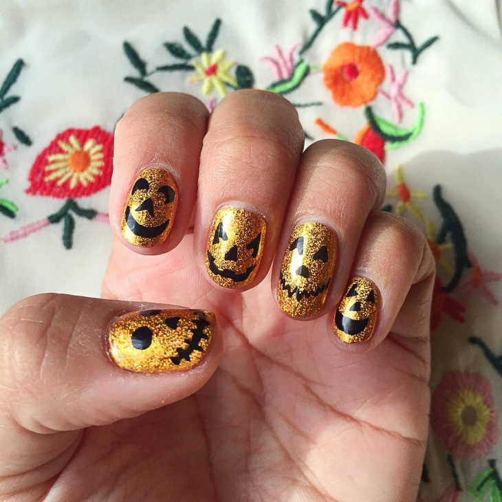 spooky pumpkin nail art idea