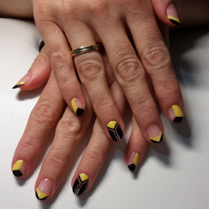 yellow and black negative space nails