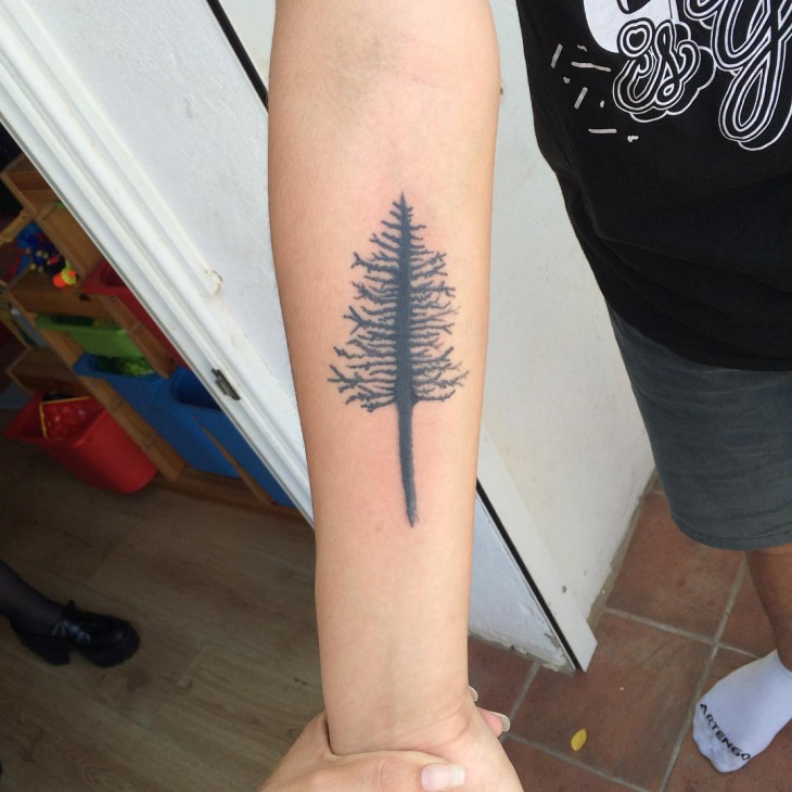 geometric pine tree tattoo