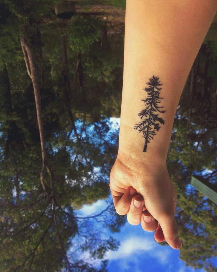 little pine tree wrist tattoo