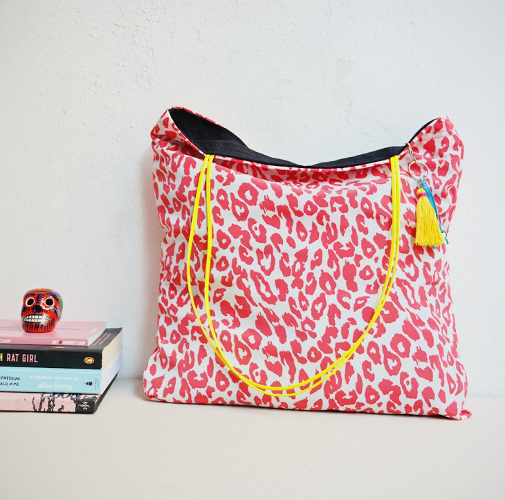 red and white animal print bag