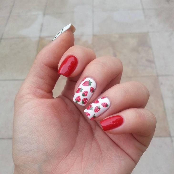 white strawberry nail design