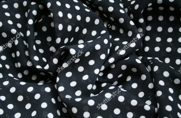 black and white polka dot background