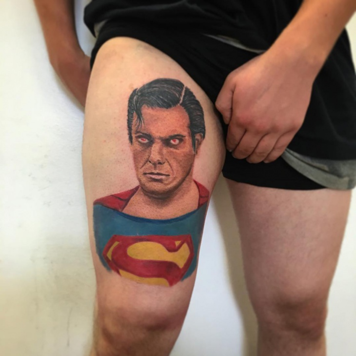 superman tattoo on thigh