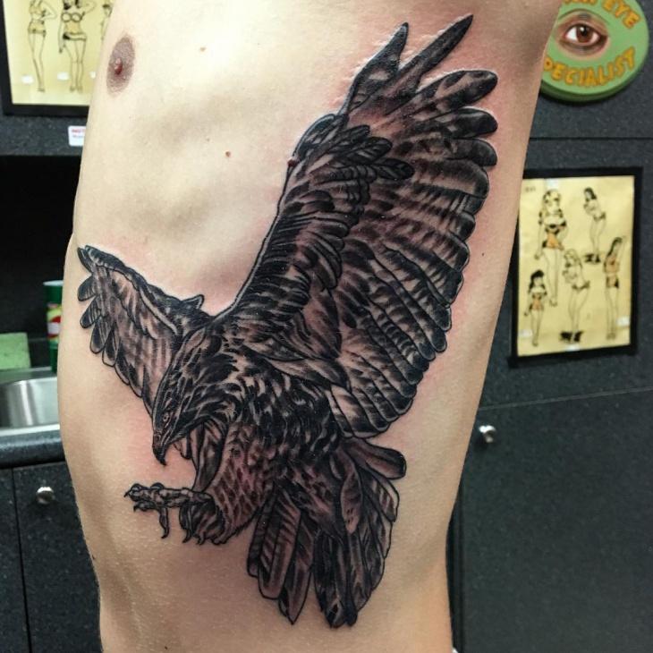 Falcon Rib Tattoo Design
