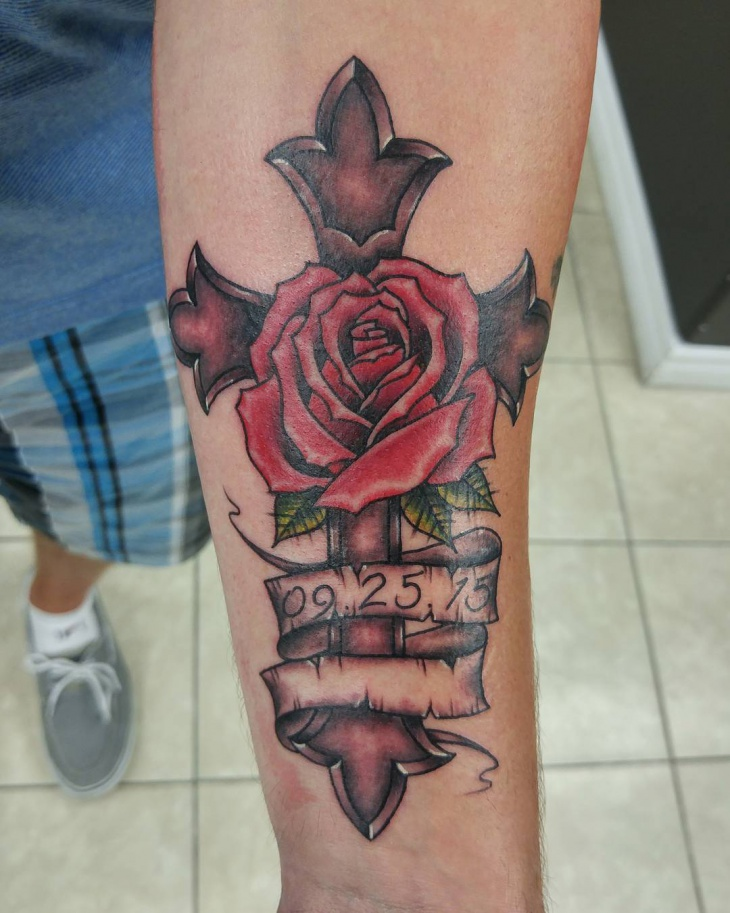 cross and flower tattoo design
