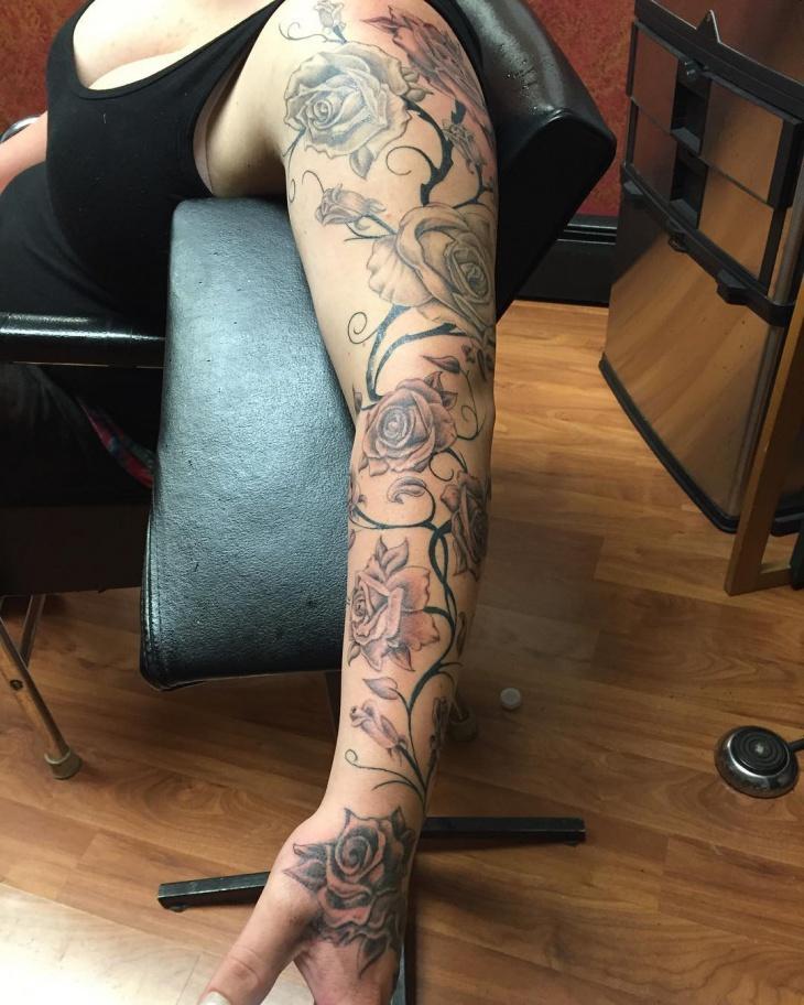 flower sleeve tattoo design idea