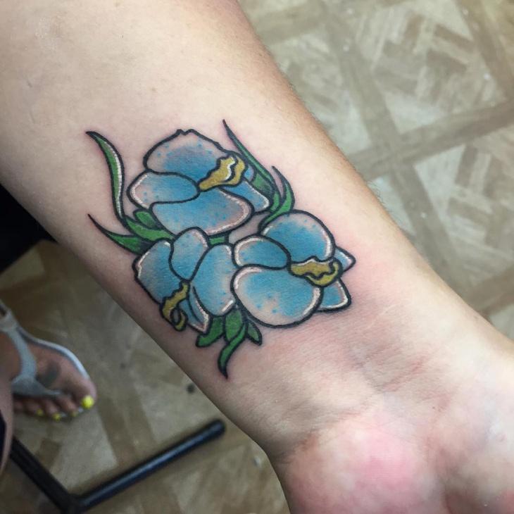 small flower tattoo on wrist
