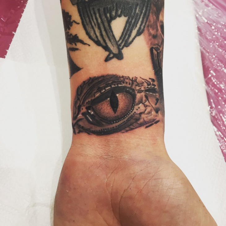 Crocodile Eye Tattoo on Wrist